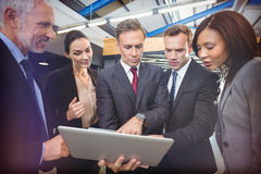 Business people looking at laptop Royalty Free Stock Photos