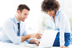 Business people looking at laptop. Smiling Royalty Free Stock Photo