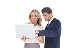 Business people looking at a laptop. On a white background Royalty Free Stock Photography