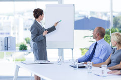 Business people looking at meeting board during conference. In office royalty free stock photography