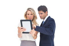 Business people looking at a pc tablet Royalty Free Stock Images