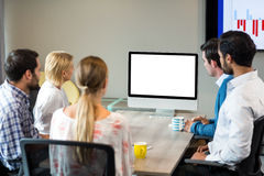Business people looking at a screen during a video conference. In the conference room stock images