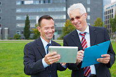 Business people looking at tablet Royalty Free Stock Image
