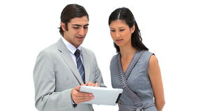 Business people looking at a tablet computer Royalty Free Stock Images