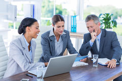 Business people looking at tablet computer Royalty Free Stock Photos