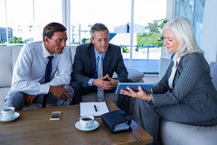 Business people looking at tablet computer Royalty Free Stock Photography