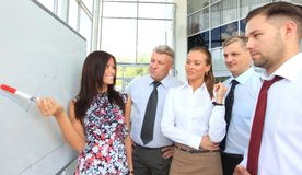 Business people looking at their leader Royalty Free Stock Photo