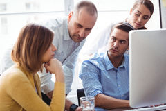 Business people looking at thoughtful coworker stock photos