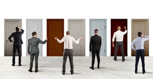 Free Business People Looking To Select The Right Door. Concept Of Confusion And Competition Stock Photos - 153926733