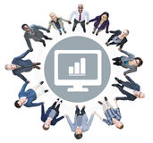 Business People Looking Up with Bar Graph Symbols Royalty Free Stock Image