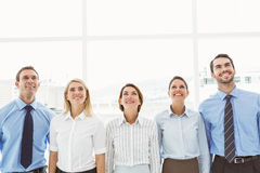Business people looking up in office Stock Photography