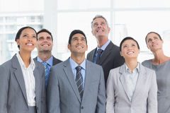 Business people looking up in office Stock Photo
