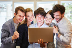Business people looking at website. In laptop computer Royalty Free Stock Image