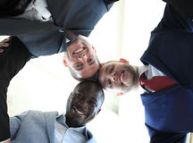 Business people. Low angle view of business people with their heads together Royalty Free Stock Image