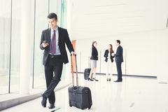 Business people with luggage in building hallway. Business people flight attendants with luggage in building hallway airport terminal Royalty Free Stock Photo