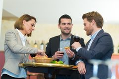Business people lunch celebration together corporate concept. Businessman royalty free stock photo