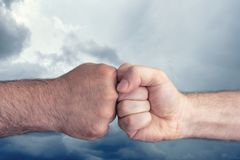 Business people make fist group on sky background ,teamwork concept,business concept stock photos