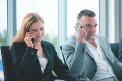 Business people making call on their mobile phone royalty free stock image