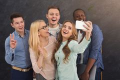 Business people making group selfie, having fun. Business people making group selfie while having fun during break in work in modern office, copy space Royalty Free Stock Photography