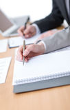 Business people making notes Stock Images