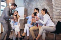 People making team training exercise during team building seminar singing karaoke. Indoor team building activities. Business people making team training exercise royalty free stock images