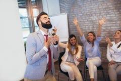 People making team training exercise during team building seminar singing karaoke. Indoor team building activities. Business people making team training exercise royalty free stock photography