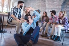 Business people making team training exercise during team building. Seminar using VR glasses Royalty Free Stock Photography