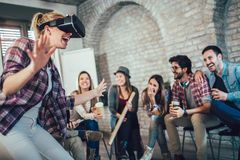 Business people making team training exercise during team building. Seminar using VR glasses stock photography