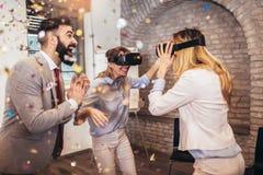 Business people making team training exercise during team building seminar using VR glasses. Having fun stock image