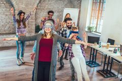 Business people making team training exercise during team building. Seminar, play a game of trust royalty free stock photography