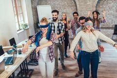 Business people making team training exercise during team building. Seminar, play a game of trust stock photos