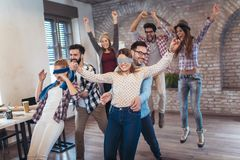 Business people making team training exercise during team building. Seminar, play a game of trust royalty free stock image