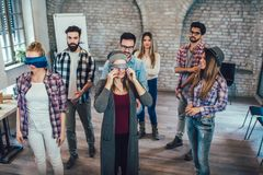 Business people making team training exercise during team building. Seminar, play a game of trust royalty free stock images