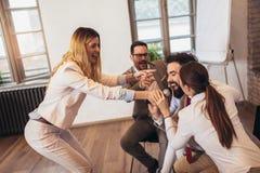 Business people making team training exercise during team building seminar singing karaoke. Having fun royalty free stock images