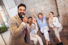 Business people making team training exercise during team building seminar singing karaoke. Having fun royalty free stock image