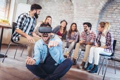 Business people making team training exercise during team building. Seminar using VR glasses Stock Photos