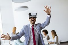 Business people making team training exercise during team building seminar using VR glasses stock images