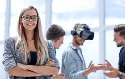 Group of startup entrepreneurs during work. Business people making team training exercise during team building seminar using VR glasses royalty free stock image