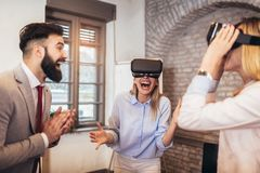 Business people making team training exercise during team building seminar using VR glasses. Having fun royalty free stock photography