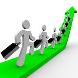 Business People Marching Up Arrow Royalty Free Stock Image