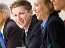 Business people in meeting. Businessman smiling at a meeting Royalty Free Stock Photos