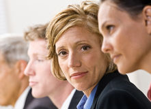 Business people in meeting. Businesswoman looking at the camera during a meeting Stock Photo