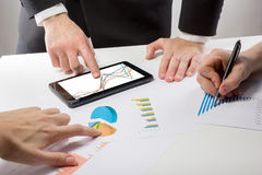 Business people on a meeting analyzing financial reports discuss Royalty Free Stock Photography