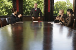 Business People Meeting Around Boardroom Table Stock Image
