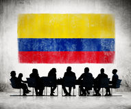 Business People in a Meeting with Colombian Flag Stock Image