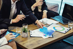 Business People Meeting Conference Discussion Corporate Concept,business team,business partners discussing documents and. Ideas,Business conference in a modern royalty free stock photo