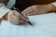 Business People Meeting Design Ideas  with pen analyzing financial documents professional investor working new start up project. Concept. business planning in stock images