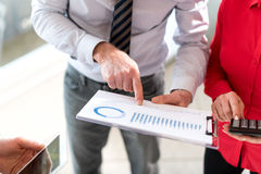 Business people in meeting discussing about financial results Royalty Free Stock Photo