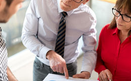 Business people in meeting discussing about financial results Royalty Free Stock Images