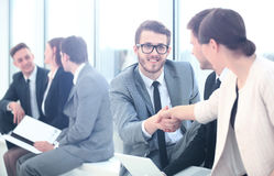 Business People Meeting Discussion Corporate Handshake Concept. Image of business partners handshaking after signing contract Royalty Free Stock Image